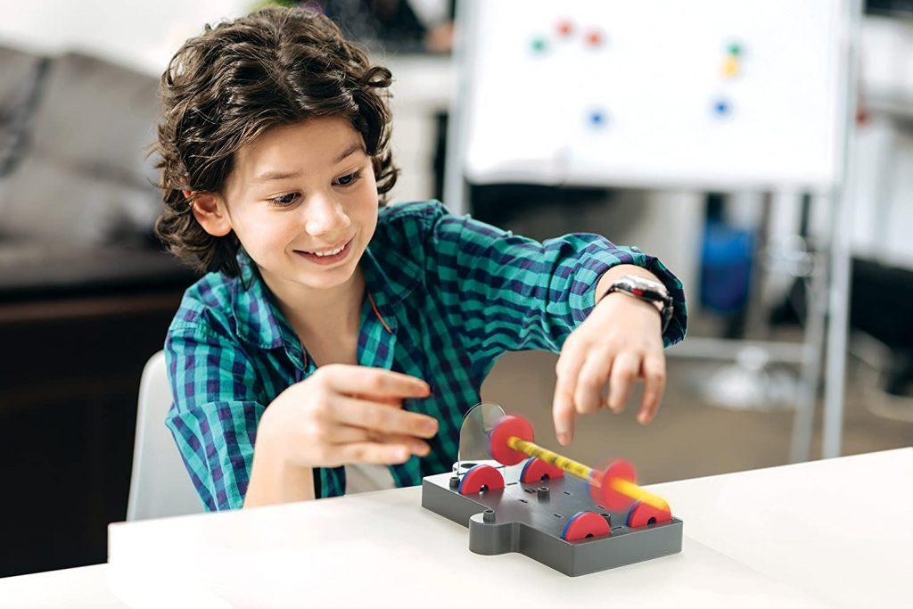 Kid experimenting with magnets